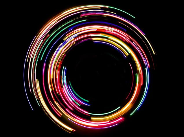 Abstract rotating neon lights on black background